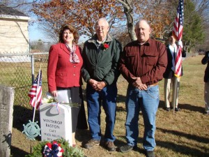 North Yarmouth Town Clerk Debbie Grover, left, with Dick Baston and Clark Baston, descendants of Revolutionary War soldier Winthrop Baston, whose new tombstone was dedicated on Veterans Day, Tuesday, Nov. 11, in Walnut Hill Cemetery.